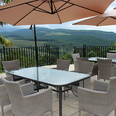 Sit on the patio and enjoy the amazing surroundings at Granny Dot's Guesthouse and Country Spot